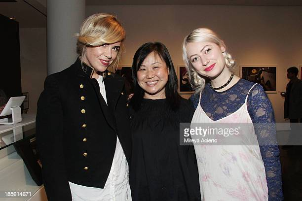 Molly Peters Song Chong and Allegra Lee attend A Milk Gallery Project Presents BG BOOM Dusan Reljin at Milk Studios on October 22 2013 in New York...