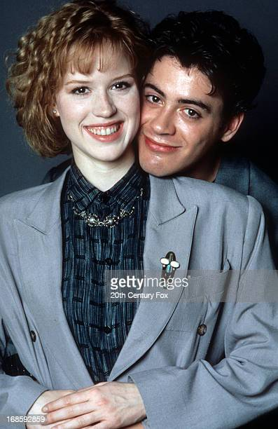 Molly Ringwald is held by Robert Downey Jr in publicity portrait for the film 'The PickUp Artist' 1987