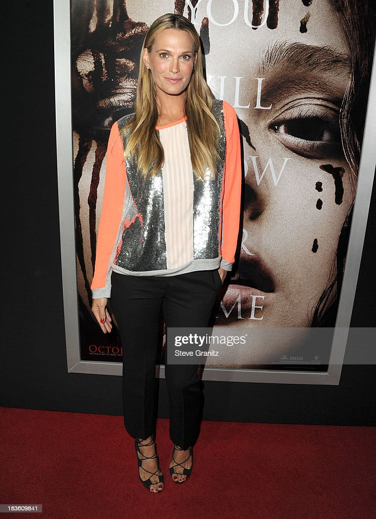 <a gi-track='captionPersonalityLinkClicked' href=/galleries/search?phrase=Molly+Sims&family=editorial&specificpeople=202547 ng-click='$event.stopPropagation()'>Molly Sims</a> arrives at the 'Carrie' - Los Angeles Premiere at ArcLight Hollywood on October 7, 2013 in Hollywood, California.