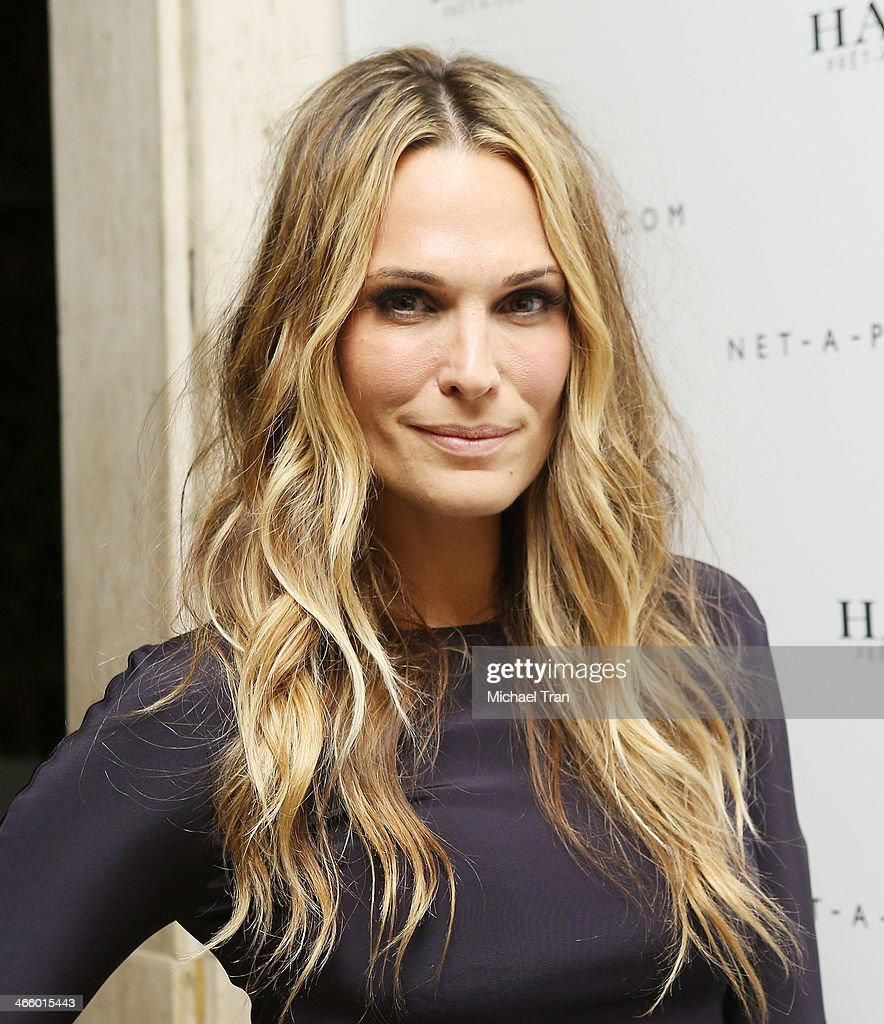 <a gi-track='captionPersonalityLinkClicked' href=/galleries/search?phrase=Molly+Sims&family=editorial&specificpeople=202547 ng-click='$event.stopPropagation()'>Molly Sims</a> arrives at the Net-A-Porter and Haney Pret-A-Couture hosts launch party held at The Standard Hotel on February 1, 2014 in Los Angeles, California.