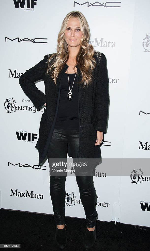 Molly Sims attends the 6th Annual Women In Film Pre-Oscar Party hosted by Perrier Jouet, MAC Cosmetics and MaxMara at Fig & Olive Melrose Place on February 22, 2013 in West Hollywood, California.