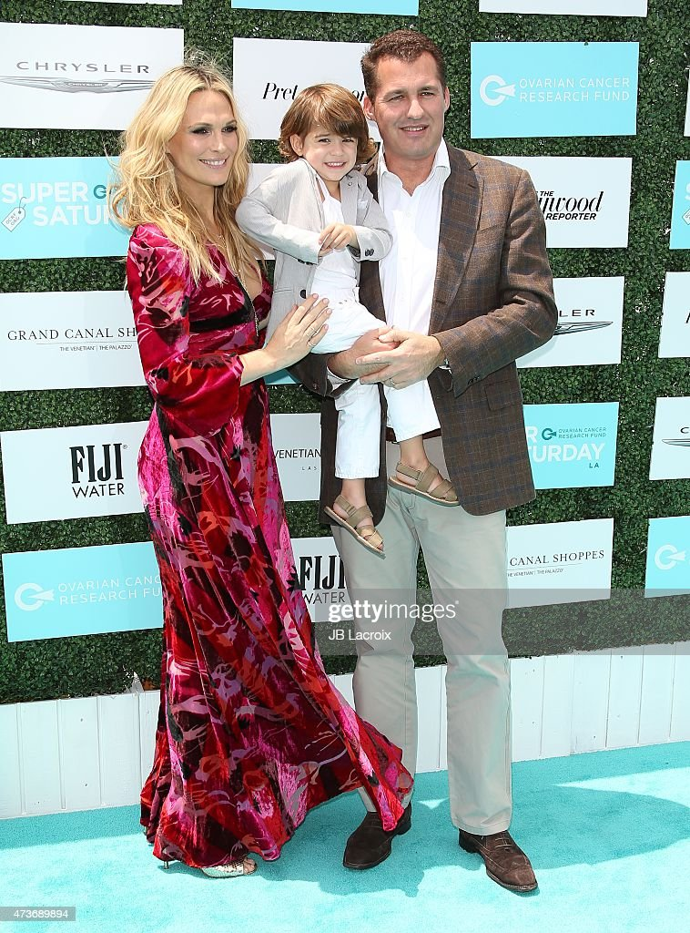Molly Sims Brooks Stuber and producer Scott Stuber attend the OCRF's 2nd Annual Super Saturday LA held at the Barker Hangar on May 16 2015 in Santa...