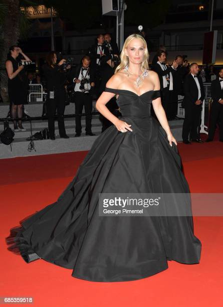 Molly Sims departs from the 'Okja' screening during the 70th annual Cannes Film Festival at Palais des Festivals on May 19 2017 in Cannes France