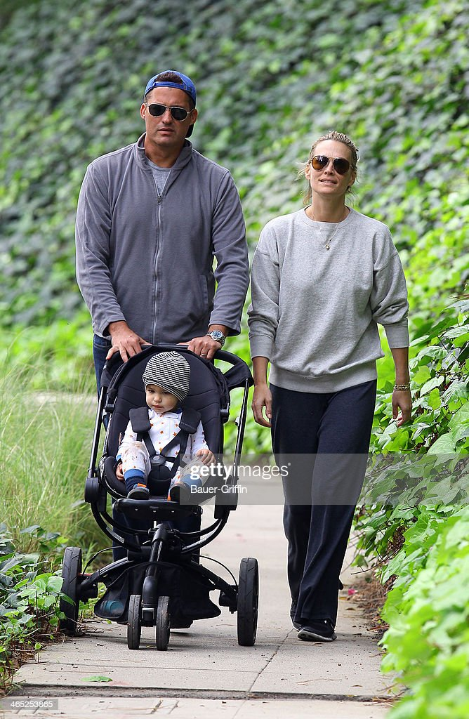 Molly Sims is seen at Coldwater Canyon Park with her husband Scott Stuber and son Brooks Stuber on January 26 2014 in Los Angeles California