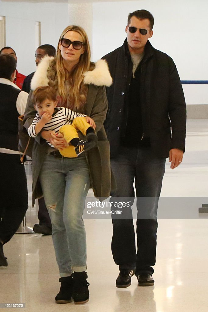 Molly Sims Scott Stuber and their son Brooks Alan Stuber are seen arriving at LAX airport on November 26 2013 in Los Angeles California