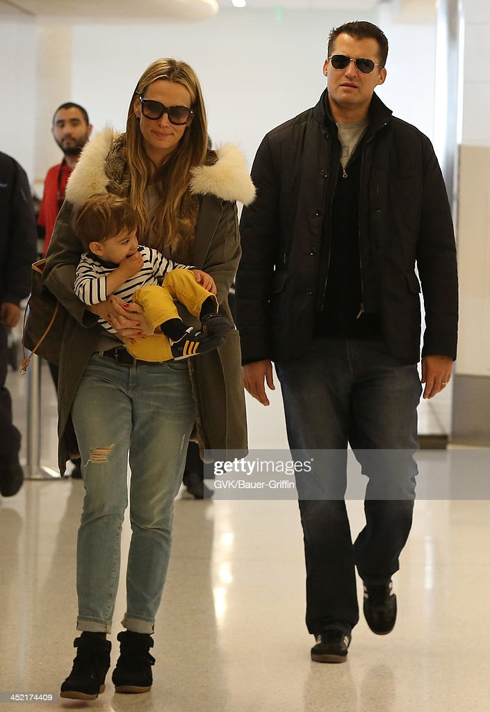 Molly Sims Scott Stuber and their son Brooks Alan Stuber are seen arriving at Los Angeles International airport on November 26 2013 in Los Angeles...