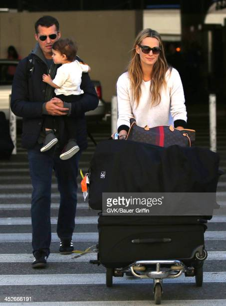 Molly Sims Scott Stuber and their son Brooks Alan Stuber are seen arriving at Los Angeles International airport on November 30 2013 in Los Angeles...