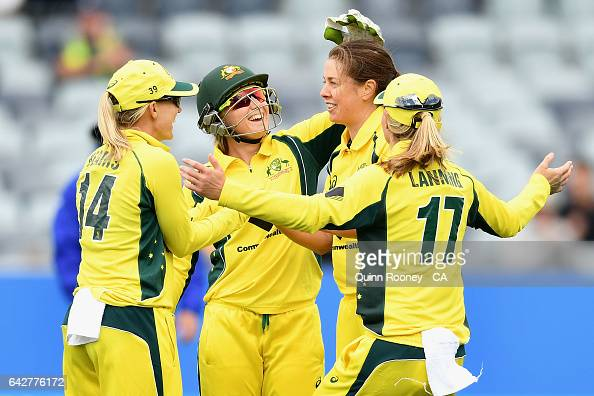 Molly Strano of Australia is congratulated by team mates after getting a wicket during the second Women's International Twenty20 match between...