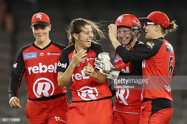 Molly Strano of the Renegades is congratulated by her teammates after dismissing Emma Kearney of the Stars during the Women's Big Bash League match...