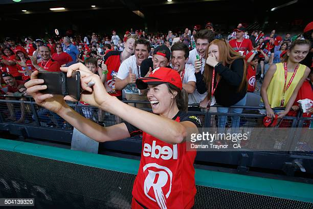 Molly Strano of the Renegades takes a selfie with fans after the Women's Big Bash League match between the Melbourne Renegades and the Sydney Thunder...