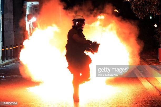 A molotov cocktail explodes in front of riot police on September 25 2013 during clashes with demonstrators in Athens Police clashed with protesters...