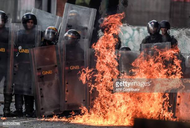 Molotov cocktail thrown by antigovernment activists explodes near members of the National Guard during clashes in Caracas on July 26 during a 48hour...