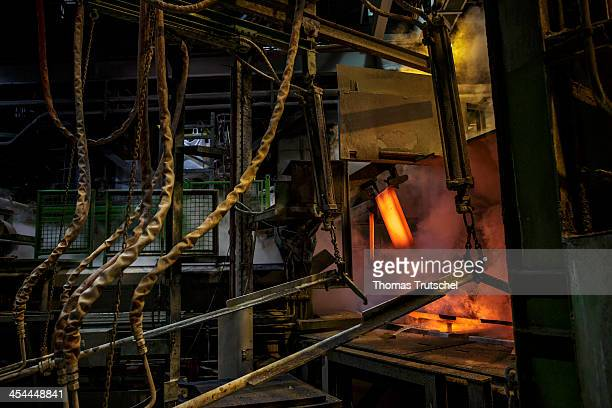 Molten copper is cast into copper anodes in the foundry of the Aurubis AG a gripper pulls the hot anodes out of the casting ladles on December 04 in...