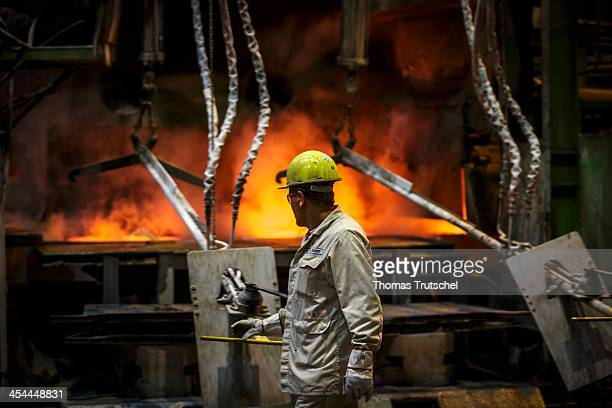 Molten copper is cast into copper anodes in the foundry of the Aurubis AG an employee is controlling the melting and casting process on December 04...