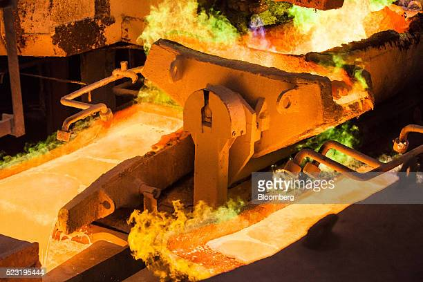 Molten copper pours into an anode casting wheel at the Aurubis AG metals plant in Hamburg Germany on Thursday April 21 2016 China has accumulated...
