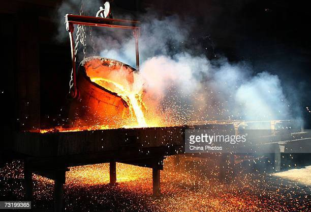 Molten ferrosilicon is poured to moulds from a furnace at a village ferrosilicon factory at Yanxiao Village February 4 2007 in Xining of Qinghai...