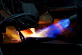 Molten gold flows from a crucible into a mould during the semiautomated gold bar manufacturing process at a precious metal refinery near Mendrisio...