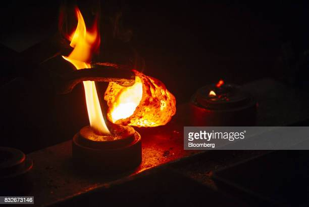 Molten gold pours into a mould during the refining of bullion at the Rand Refinery Ltd plant in Germiston South Africa on Wednesday Aug 16 2017...