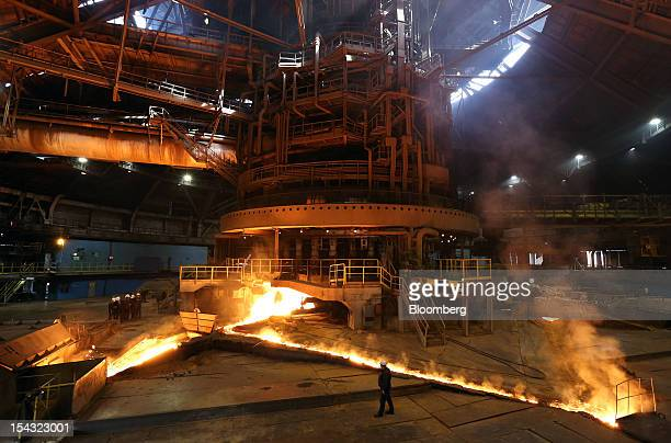 Molten iron runs through floor channels after leaving the blast furnace at the OAO Novolipetsk Steel plant also known as NLMK in Lipetsk Russia on...