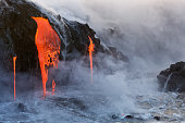Lava from the Kilauea Volcano eruption in Hawaii entering the pacific ocean