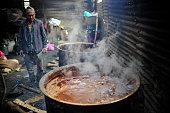 Molten Raw Hardened molasses to prepare molasses Chaku on 06 January 2015 at Tokha Kathmandu Nepal for the celebration of Maghe Sankranti Festival...