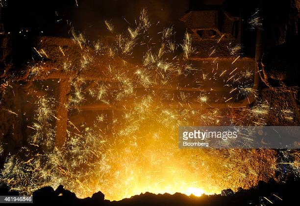 Molten stainless steel is poured into a ladle on the production line inside the Zelezara Smederevo doo steel plant in Smederevo Serbia on Wednesday...