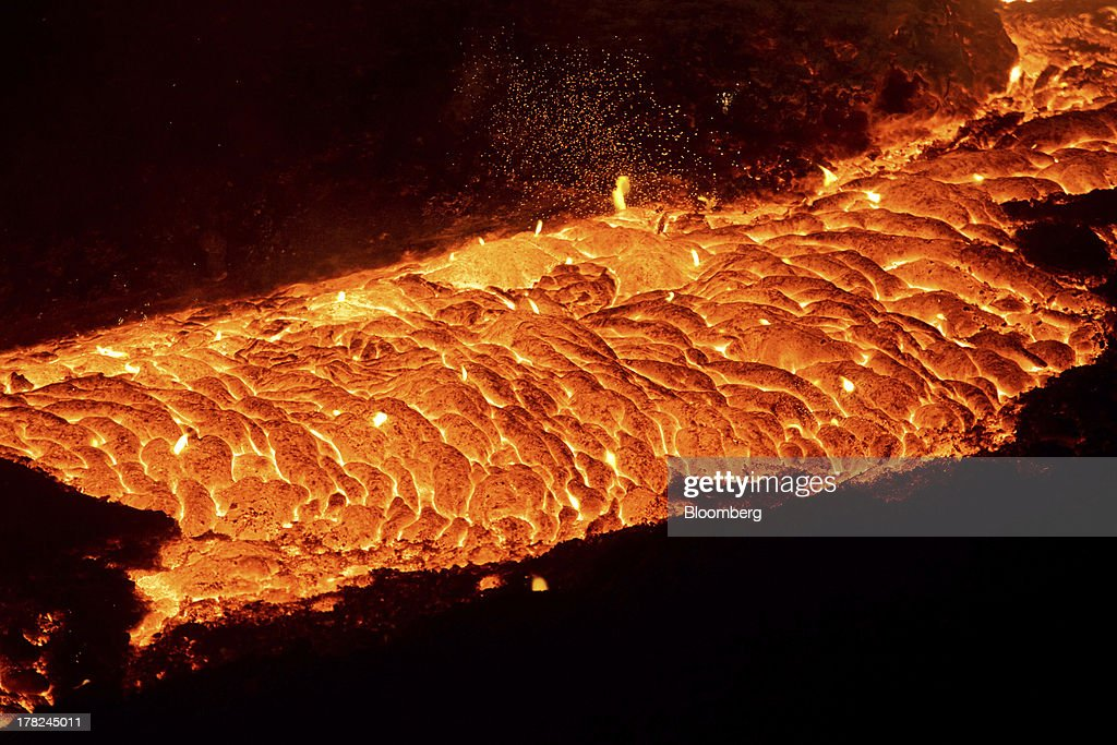 Molten steel pours from a blast furnace at ArcelorMittal's steel plant in Ostrava, Czech Republic, on Monday, Aug. 26, 2013. ArcelorMittal, the world's biggest steelmaker, said steel shipments will rise 1 percent to 2 percent this year compared with an earlier forecast of 2 percent in May. Photographer: Martin Divisek/Bloomberg via Getty Images