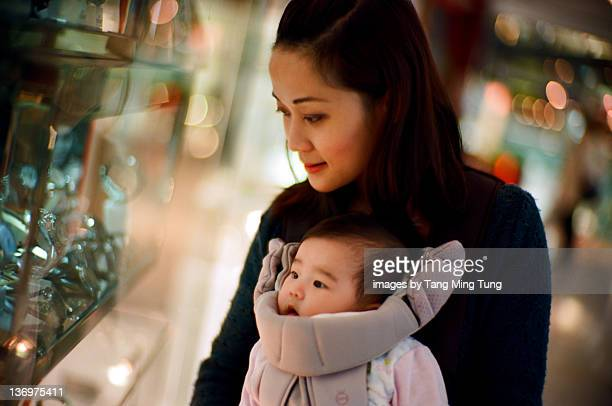Mom and baby at window shopping