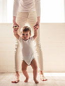 Cropped image of beautiful mom stepping with her cute baby
