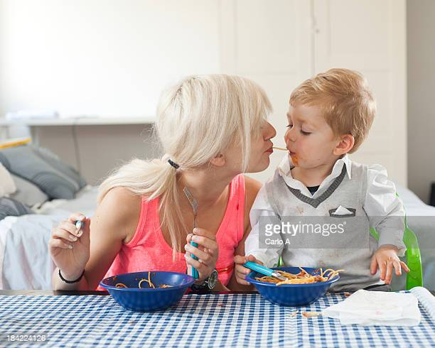 Mom and baby eating spaghetti