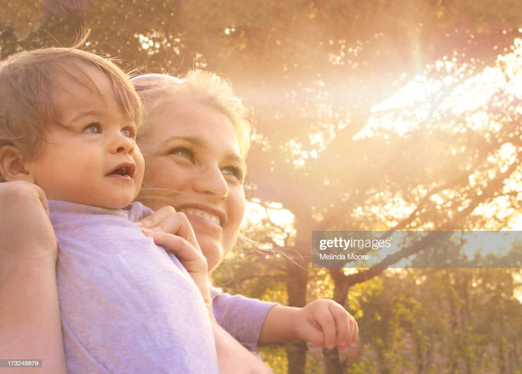 Mom and baby look into the light : Stock Photo
