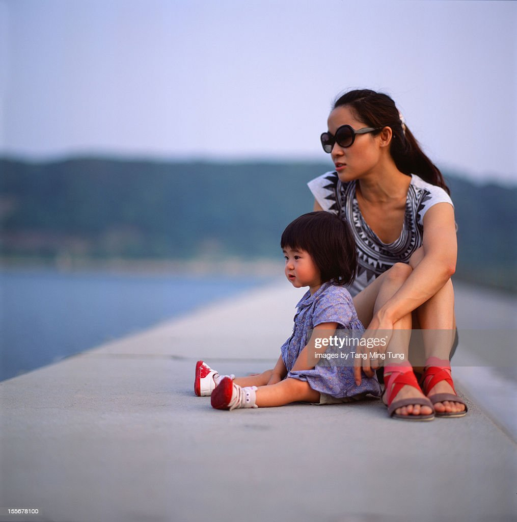 Mom and baby looking at the sea : Stock Photo