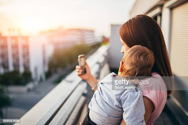 Mom and baby on the balcony,making selfie