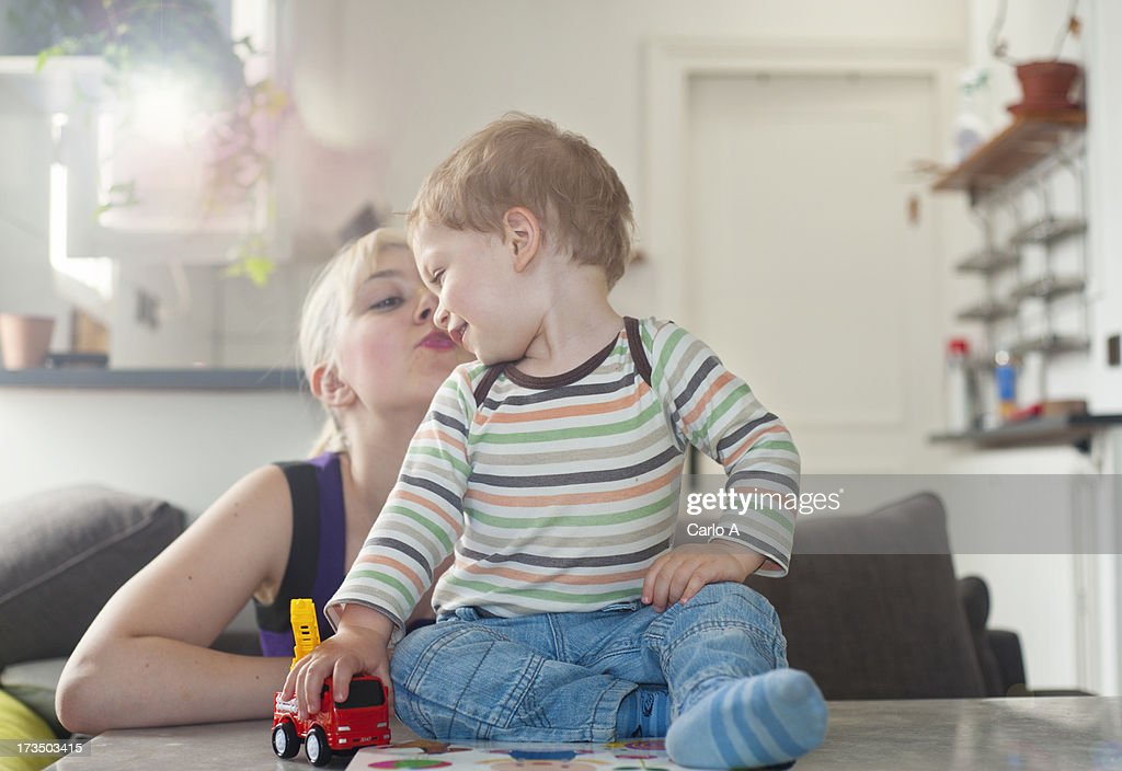 Mom and boy at home : Stock Photo