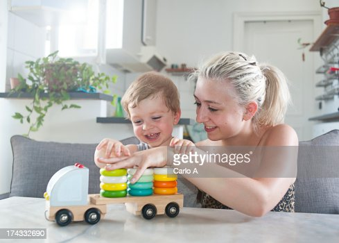 Mom and boy playing : Stock Photo