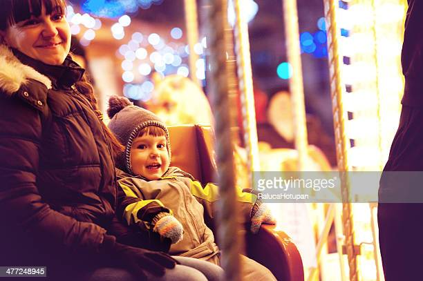 mom and child in merry-go-round