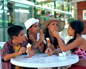 Mom and children eating ice cream