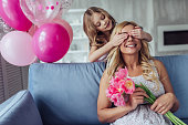 I love my mom! Attractive young woman with little cute girl are spending time together at home. Happy family concept. Mother's day.