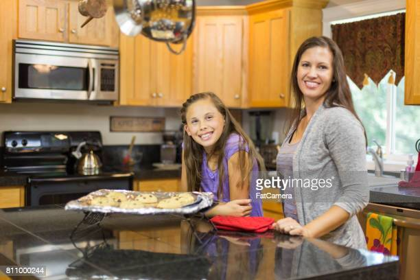 Mom and daughter cooking together in kitchen