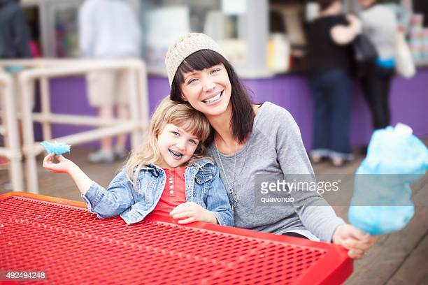 Mom and Daughter Eating Cotton Candy