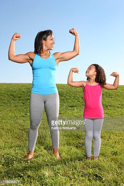 Mom and daughter flexing their muscles