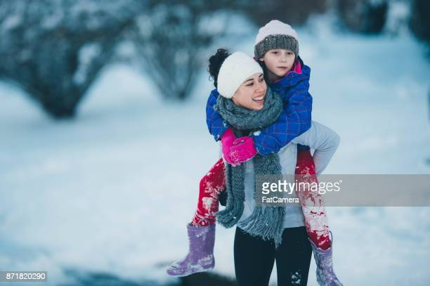 Mom and daughter in the snow