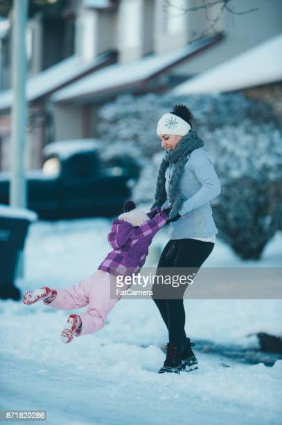 Mom and daughter playing in the snow