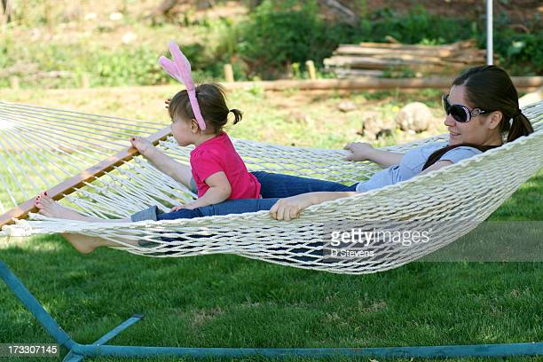 Mom and Daughter relaxing on hammock