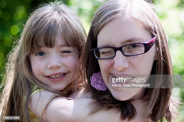 Mom and daughter winking