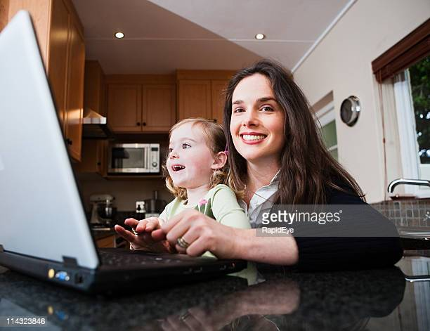 Mom and daughter with laptop computer