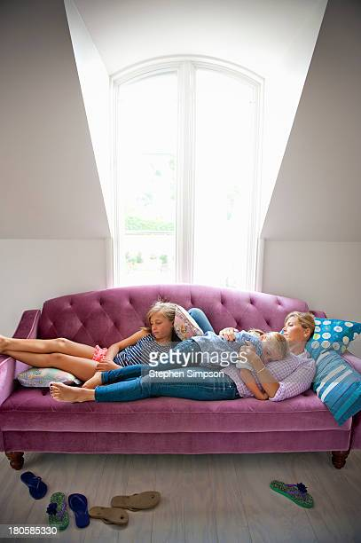 Mom and daughters, afternoon nap on the couch