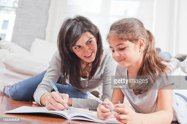 Mom and doughter writing together