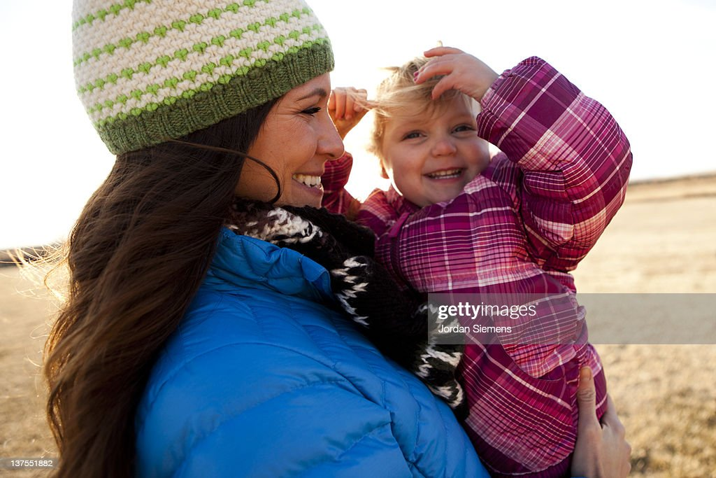 Mom and girl laughing with excitement. : Stock Photo