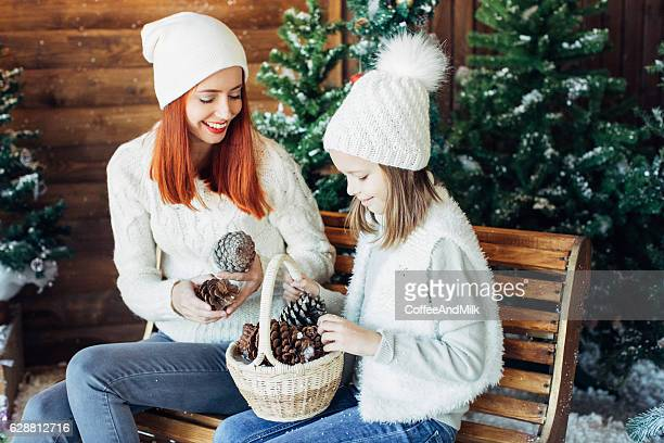 Mom and her daughter playing with snow